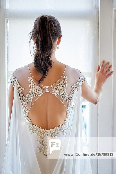 Dress detail  leaf embroidery  Bride trying on wedding dress in atelier of clothing designer  Bilbao  Spain