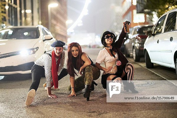 Group of young people fooling around on Munich streets. Germany.