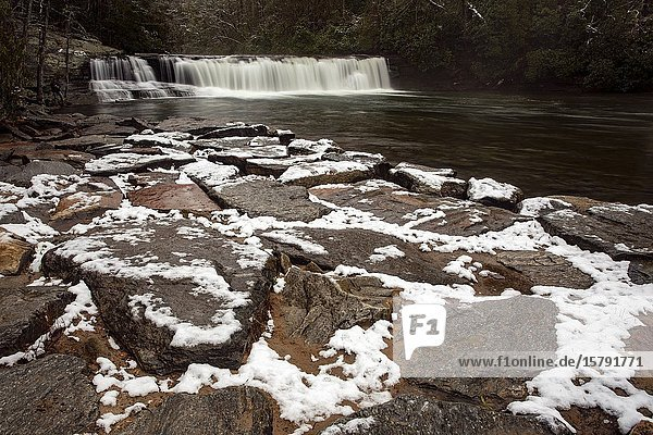 Snow on the rocks at Hooker Falls on the Little River - Dupont State Recreational Forest  near Brevard  North Carolina  USA.