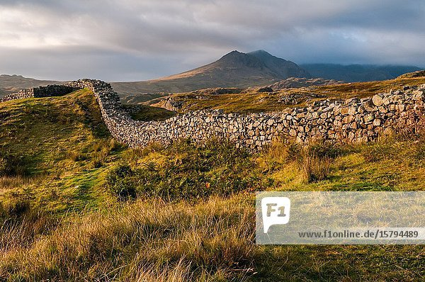 Sunset view of the Hardknott Roman Fort in the English Lake District and the Scafell Mountain Range in the background.