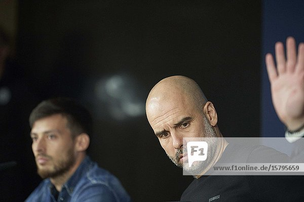 Pep Guardiola  David Silva during a press conference ahead of their UEFA Champions League round of 16 first leg match against Real Madrid at Santiago Bernabeu Stadium on February 25  2020 in Madrid  Spain