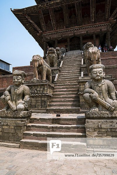 Staircase flanked by stone figures of the temple guardians at Nyatapola Temple in Bhaktapur  Kathmandu valley  Nepal.