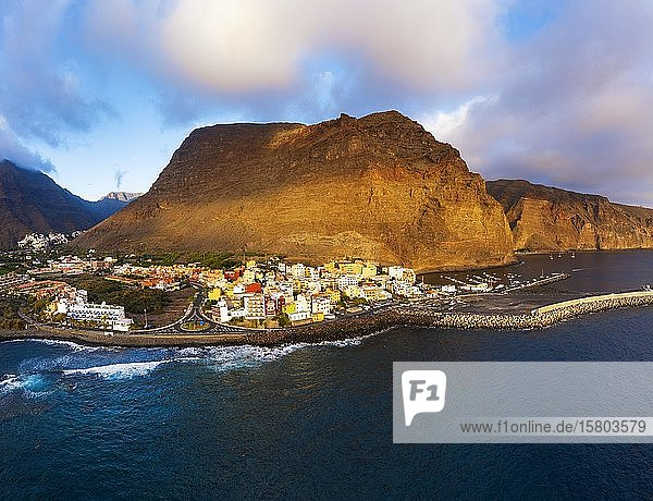 Vueltas with fishing harbour and mountain Tequergenche in the evening light  Valle Gran Rey  aerial view  La Gomera  Canary Islands  Spain  Europe