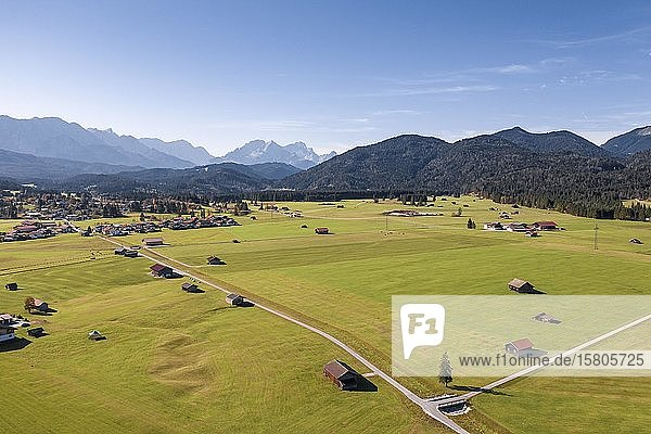 Aerial view  fields with barns  Bavarian foothills of the Alps  Werdenfelser Land  Wetterstein range  Upper Bavaria  Bavaria  Germany  Europe