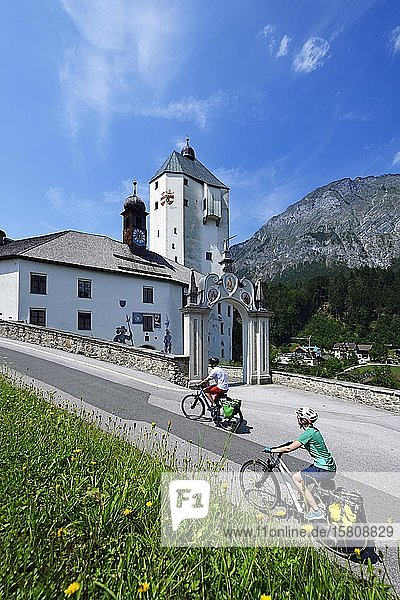Cyclists in front of the pilgrimage church Mariastein  Wörgl  Kitzbühel Alps  Tyrol  Austria  Europe