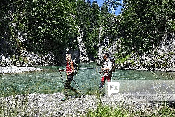 Hikers at the Entenloch  the rocky outcrop of the Tiroler Ache at the Klobenstein  Chiemgau  Upper Bavaria  Bavaria  Germany  Europe