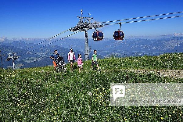 Family hiking on the summit panorama trail of the Hohe Salve  Hopfgarten  Brixental  Kitzbühel Alps  Tyrol  Austria  Europe