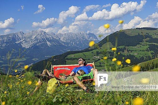 Hikers at the Kraftalm  in the background the Wilder Kaiser Mountains  Hohe Salve  Itter  Kitzbühel Alps  Tyrol  Austria  Europe