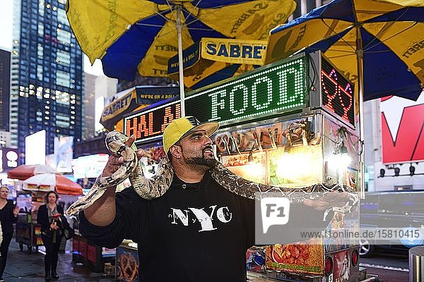 New Yorker gets photographed with Python  Times Square  Manhattan  New York City  New York State  USA  North America