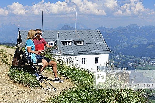 Hikers on the summit panorama trail of the Hohe Salve take a break on the summit  Hopfgarten  Brixental  Kitzbühel Alps  Tyrol  Austria  Europe