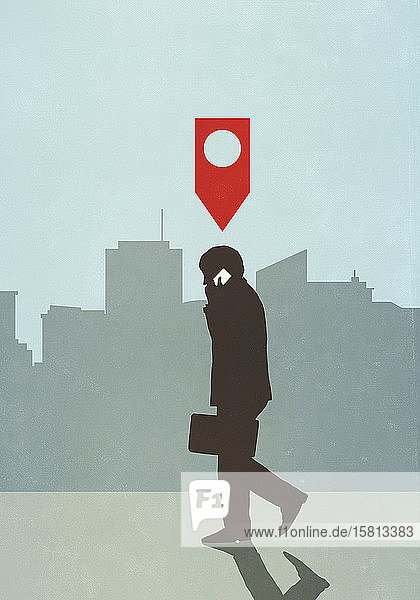 Map pin icon above businessman walking and talking on smart phone in city