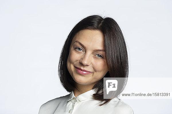 Portrait confident  smiling brunette woman
