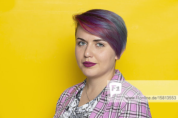 Portrait confident young woman with blue and red hair