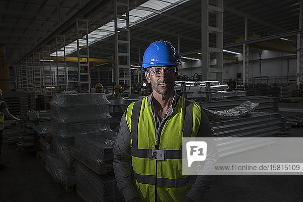 Portrait confident  serious worker in dark steel factory