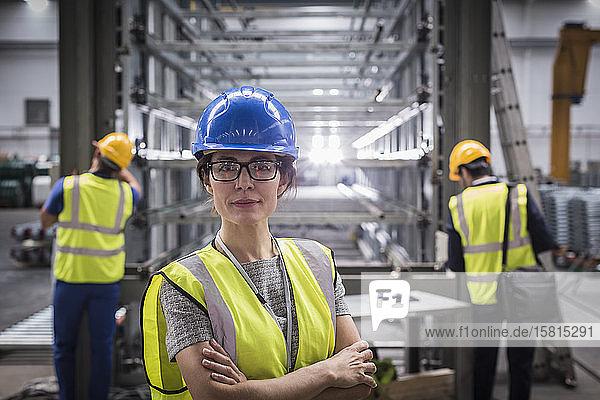 Portrait confident female supervisor in steel factory Portrait confident female supervisor in steel factory