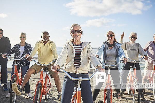 Portrait smiling  confident active senior friend tourists bike riding Portrait smiling, confident active senior friend tourists bike riding