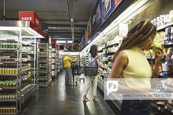 Women shopping in supermarket Women shopping in supermarket
