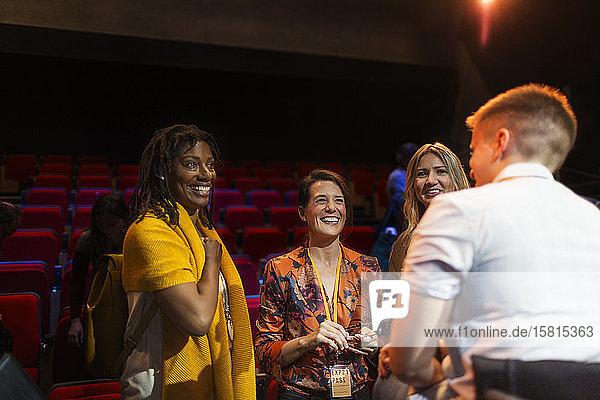 Women speakers talking on stage