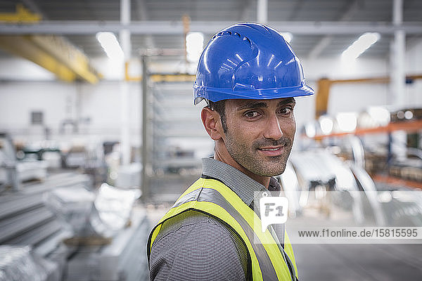 Portrait confident male worker in factory Portrait confident male worker in factory