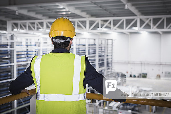 Male supervisor on platform in factory