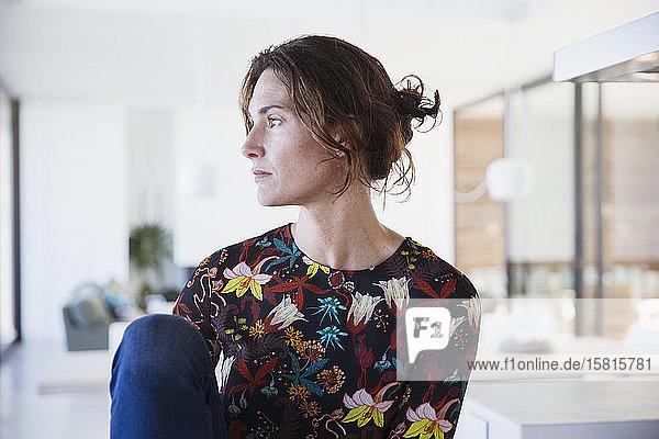 Serious  pensive brunette woman looking away