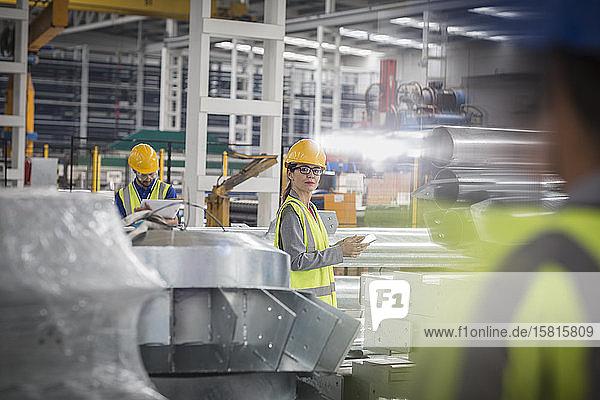 Workers in steel factory Workers in steel factory