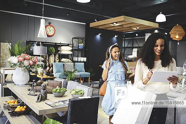 Women shopping in home decor shop Women shopping in home decor shop