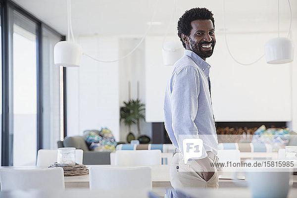 Portrait smiling  confident man in kitchen