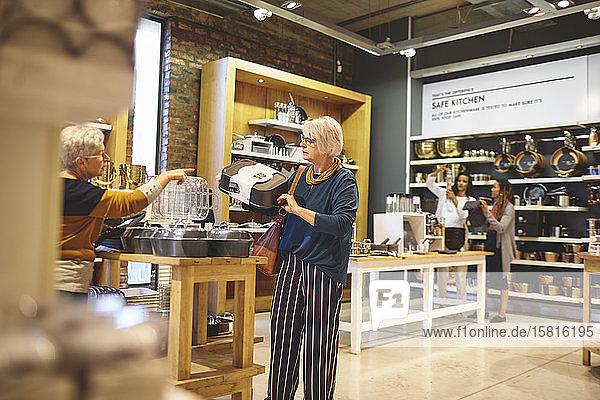 Senior women shopping for bakeware in home goods store