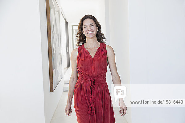 Portrait smiling  confident brunette woman walking in corridor
