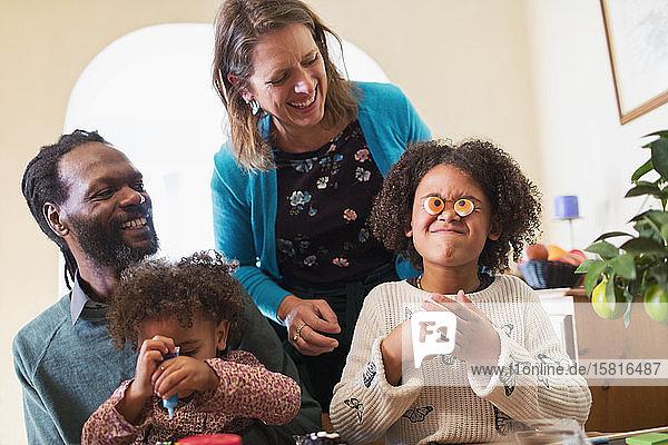 Playful family decorating cupcakes Playful family decorating cupcakes