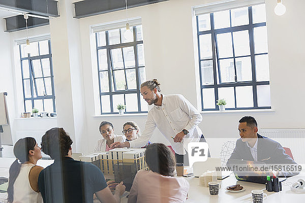 Male architect leading conference room meeting