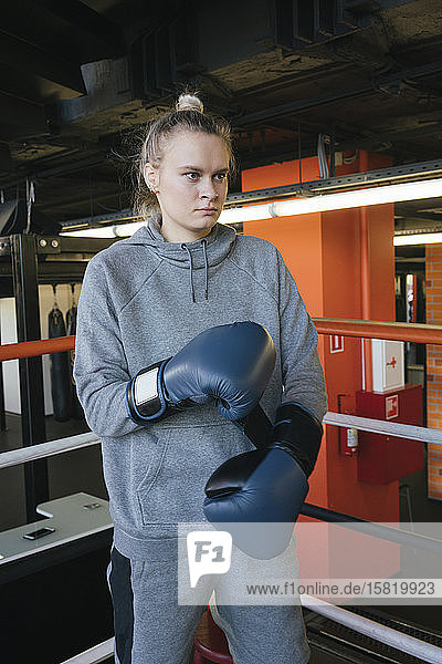 Portrait of a female boxer in ring