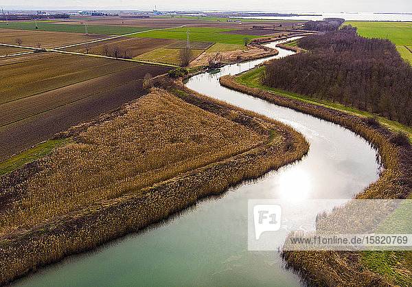 Italy  Friuli Venezia Giulia  Marano  Aerial view of Venetian Lagoon and countryside fields in autumn