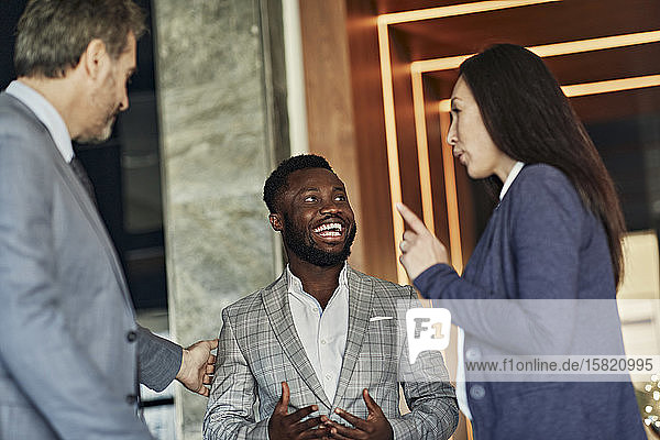Business people meeting in hotel lobby