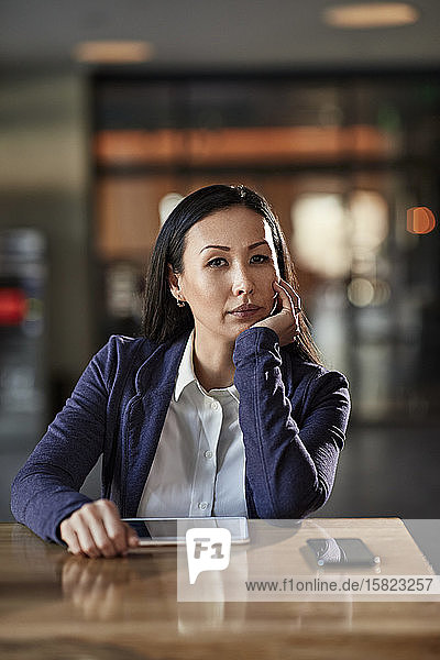 Portrait of a businesswoman at table