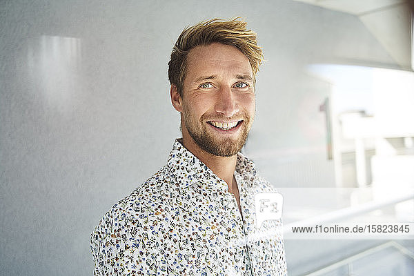 Portrait of happy young man wearing patterned shirt