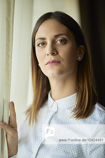 Portrait of serious businesswoman at the window