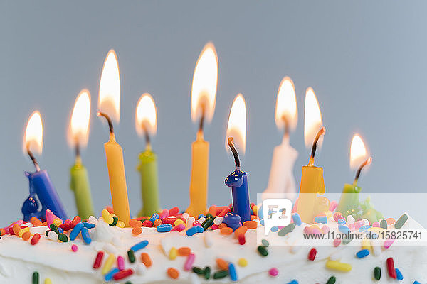 Lit birthday candles on cake