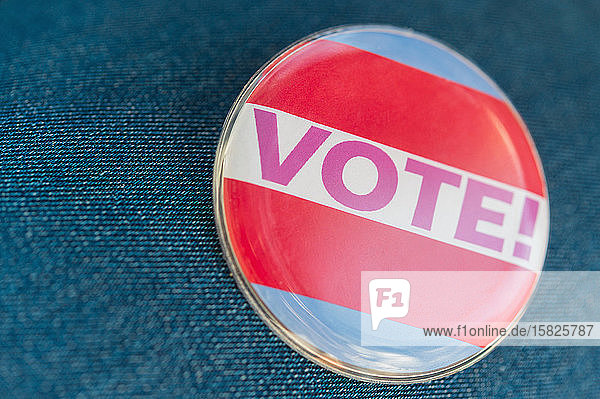 Close up of Vote button on jeans fabric