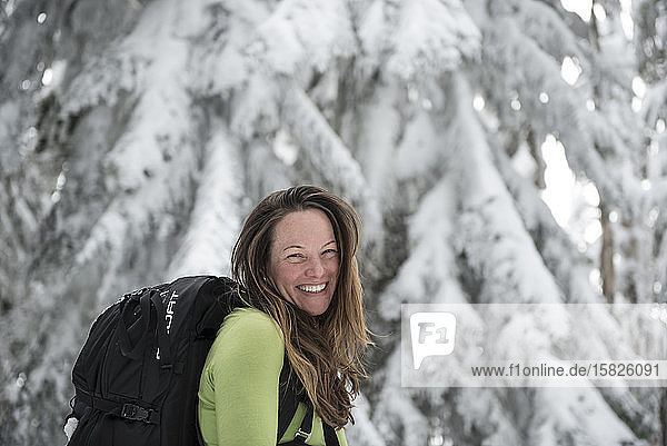 A portrait of a woman outside while skiing.