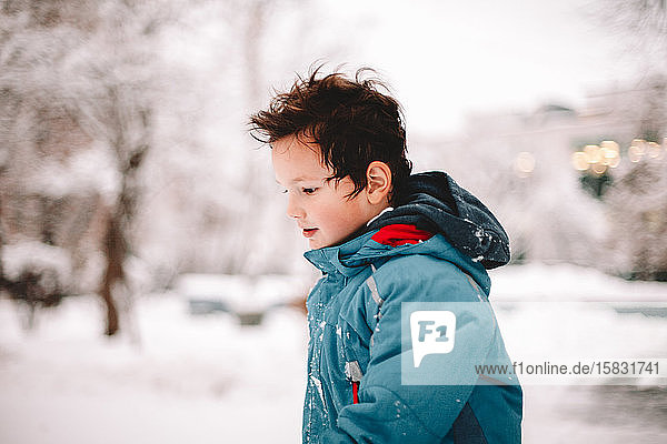 Boy walking in park during winter