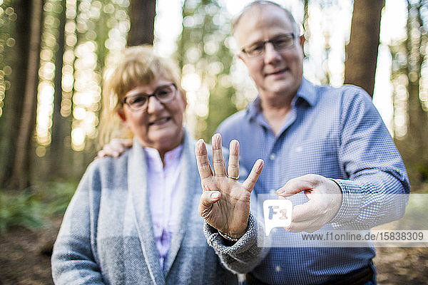 older couple hold out 40 with fingers during 40th anniversary