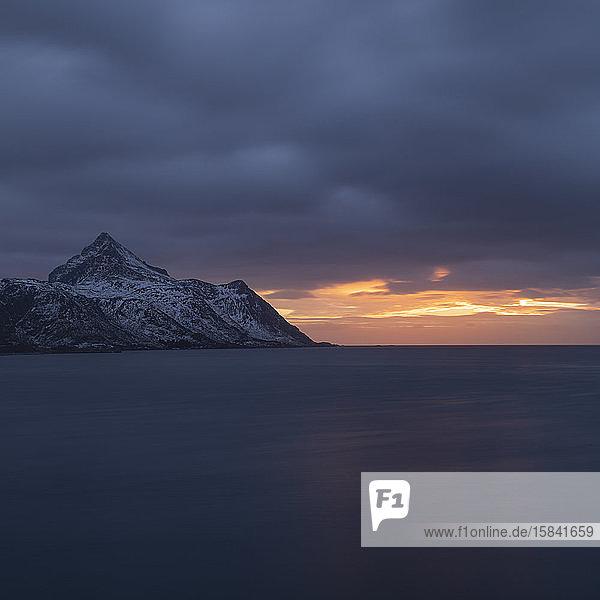 Stornappstind mountain peak rises over Nappstaumen  Lofoten Islands  Norway