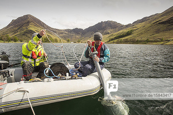 Dr Jeff Warburton of Durham University preparing to take sediment cores from the bottom of Buttermere Lake in the Lake District National Park as part of a study to look at how land use change