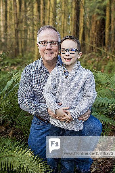 Outdoor Portrait of Grandpa and grandson.