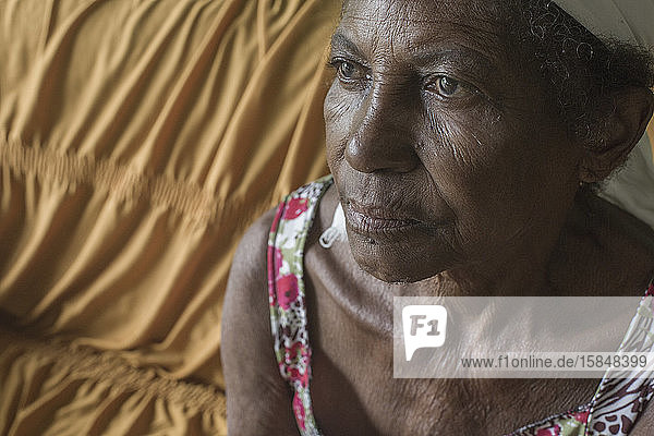 Senior Afro-Brazilian woman from north Minas Gerais  at home