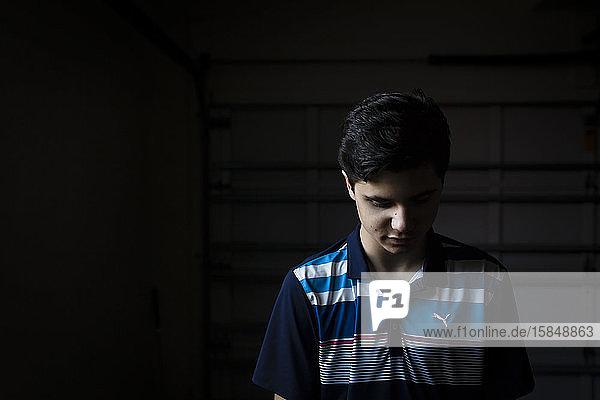 Portrait of a Teen Boy Looking Down