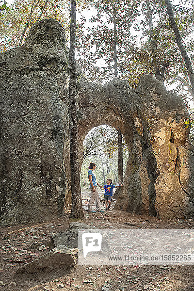 Mom and son under a natural arch in a rock at Huasca de Ocampo  Mexico