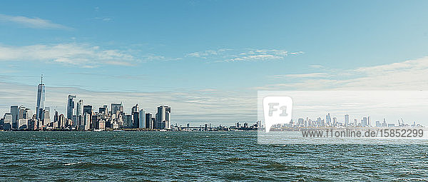 Panoramic view of the New York City skyline taken from the water.